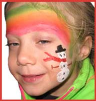 A snowman is painted at the end of the rainbow on this child's face.  Or should we say snow person?