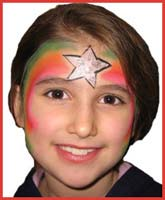 A chanukah star shines on this girls face for holiday entertainment.  She's the star of this party!
