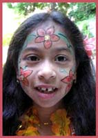 The birthday girl wanted to have a hula dance party, so Daisy Doodle came to paint her face with beautiful flowers, followed by a dance party.