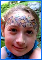 This child chose to have a flower lei painted on her face to complement her hawaiian dance costume.
