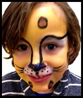 This boy wanted to be facepainted as a leopard animal at a manhattan ny birthday party