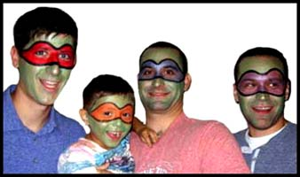 This birthday boy's father and uncles all got facepainted as ninja turtles.  What a fun family!