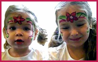 These girls got their faces painted with rainbow flower princess crowns at a birthday party in Westchester NY