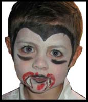 Facepainter Daisy Doodle turns this boy into a fearsome vampire for his birthday party in Brooklyn NY.  Stay out of his way!