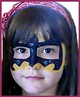 Girls want to be facepainted as superheros at their birthday parties too! Here we have a batgirl facepainting. You go, girl!