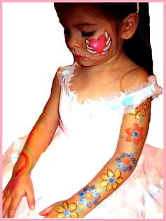 A girl loved getting her face painted and her arms body painted by Daisy Doodle at a childrens party in Manhattan ny