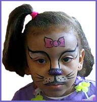 Daisy Doodle transforms a child into Hello Kitty with her facepainting skills at a Hula dance party in bronx ny