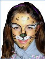 Daisy Doodle face paints a girl as a cougar for kids birthday party facepainting entertainment in Brooklyn ny