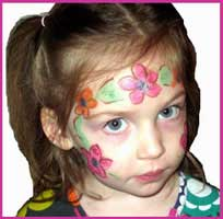 A girl is facepainted as a flower princess at this hawaiian themed party in brooklyn ny.  Pink flowers, of course!