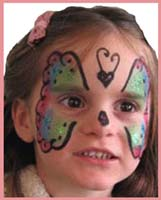 A girl requested her face to be painted as a rainbow butterfly, with glitter of course, at a kids party in ny.