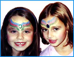 Facepainting isn't just for kids--older girls like to be facepainted too at birthday parties!