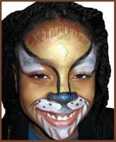 A girl becomes a lion with Daisy Doodle's face painting party entertainment in Queens ny