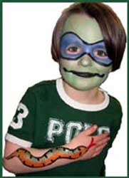 Daisy Doodle facepaints a boy as a ninja turtle and body paints his arm with a snake for party entertainment in Queens NY.  Don't make him mad!