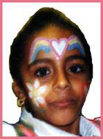 Birthday party face painting includes lots of rainbows, flowers and hearts for girls facepainting entertainment