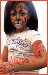 A girl is requested facepainting as a tiger and her body painted with rainbow hearts for kids entertainment in Westchester