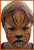 Daisy Doodle facepainted this boy as a tiger at a kids party in brooklyn, where the theme was animal facepainting