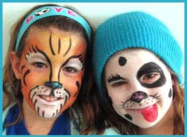 2 older girls are facepainted at a company party in Connecticut; one kids is painted as a dalmation, the other face is a tiger.