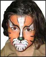 A boy requested a Tiger face painting at a childrens birthday party in nyc