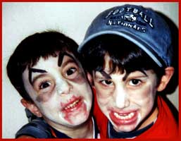 These 2 boys get their faces painted as vampires at a childrens party in Westchester New York.  They want to suck your blood!