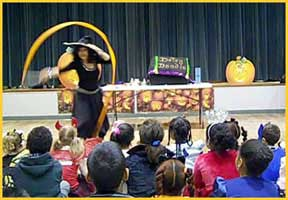 daisy doodle kids halloween magician performs a dramatic childrens halloween magic show for a
