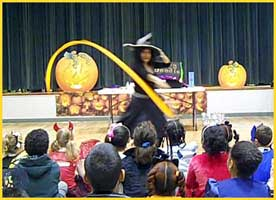 Daisy Doodle, childrens halloween party magician, performing a kids magic show with Halloween music and dance for a children's party