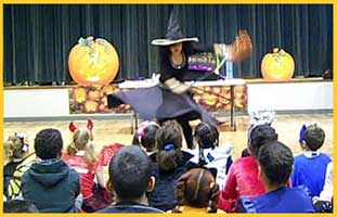 Daisy Doodle's Halloween magic show starts with her flying out on her witch's broomstick to halloween music