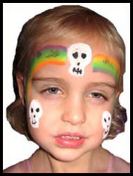This girl has her face painted with halloween skulls as part of a halloween rainbow princess facepainting