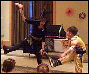 Magician Daisy Diabolica and child volunteer must do the monster mash dance to activate the magic