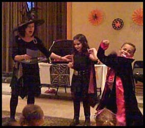 The kids dressed as vampires get to act out a halloween poem