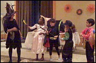 These children prepare to use their magic wands to help magician Daisy Doodle Diabolica make a halloween pumpkin pie