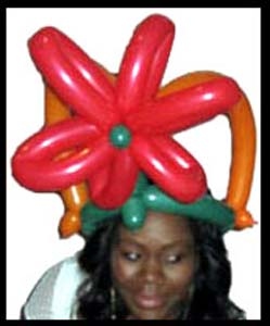 Daisy Doodle twisted herself a balloon holiday hat for a Chanukah party in Brooklyn ny