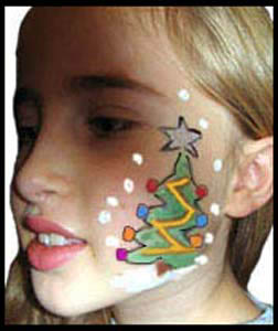 Girl gets her face painted with Christmas tree