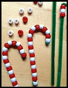 Kids string beads to make christmas candy canes as their craft project in Manhattan ny