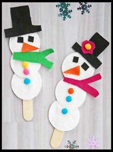 Kids assemble snowman craft project at their christmas party in Bronx ny