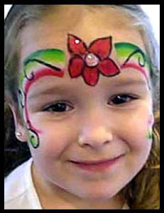 Girl is face painted with a Christmas poinsetta crown