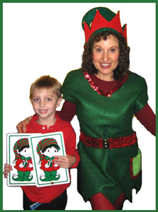 Boy poses for picture with elf character at magic show in Bronx NY