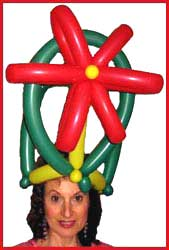 Daisy Doodle made herself a poinsetta xmas balloon hat for  twisting balloons at a childrens holiday party