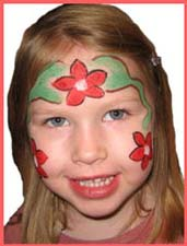 a poinsetta princess facepainting was chosen by this girl at a chrismas corporate party.