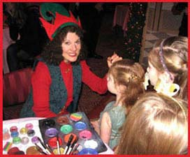 Christmas elf Daisy Doodle is facepainting at a kids holiday party in nyc