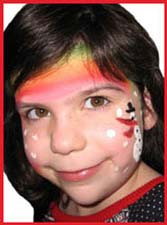 A snowman under a rainbow is facepainted on a girls cheek at a corporate holiday party
