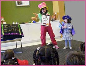 Magician Daisy Doodle shows the kids the magic that just happened at this corporate Christmas party.
