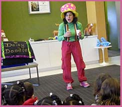 Childrens magician Daisy Doodle wants to make it snow at the holiday Christmas party magic show in Manhattan NY