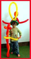 This child shows off his balloon outfit at this birthday party