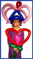 Girls balloon hat at a childrens birthday party in nyc