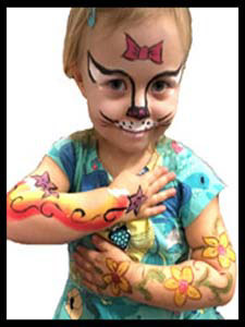Birthday girl gets arms and face painted at her party
