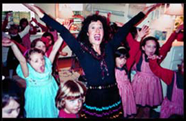 Childrens entertainer Daisy Doodle dancing the YMCA with kids at birthday party in nyc