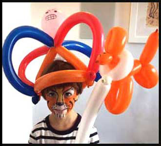 Child with twisted balloons at his birthday party