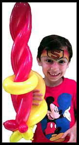 Boy with balloon sword at restaurant childrens party entertainment