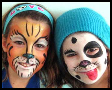 Older children get their faces painted at Kids Day party