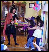 Childrens entertainer Daisy Doodle doing wizard magic for kids party entertainment in new york